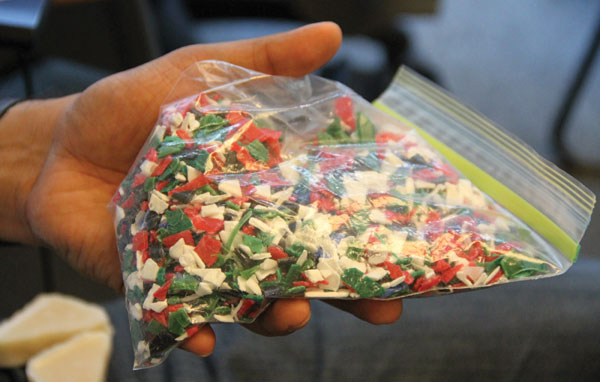 A bag of shredded plastic is used as feedstock in the GreenMantra Technologies process.