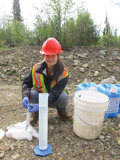 Sabrina Clarke, a student at the Yukon Research Centre, examines ways of cleaning up water at a mine site operated by Victoria Gold.
