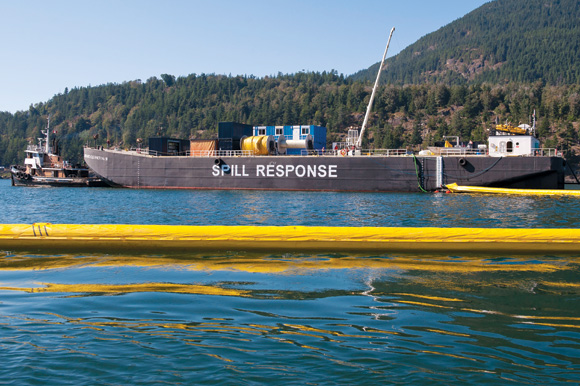 Western Canada Marine Spill Response Corp.'s tank barge, which can hold 4,000 tonnes, or about 29,000 barrels, of oil, near a containment boom during a recovery exercise in Howe Sound, BC.