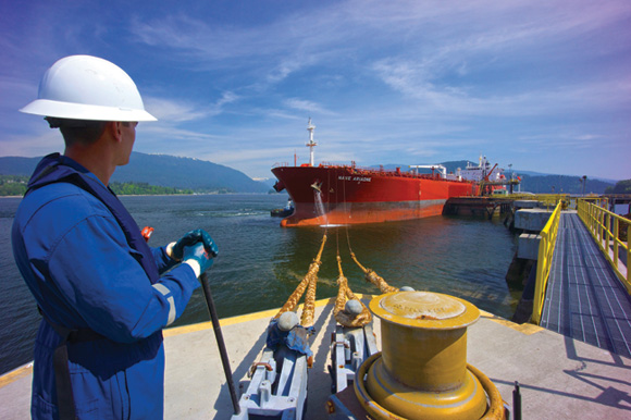 A Kinder Morgan employee prepares a tanker ship for departure at Trans Mountain's Westridge Marine Terminal in Burnaby, BC.
