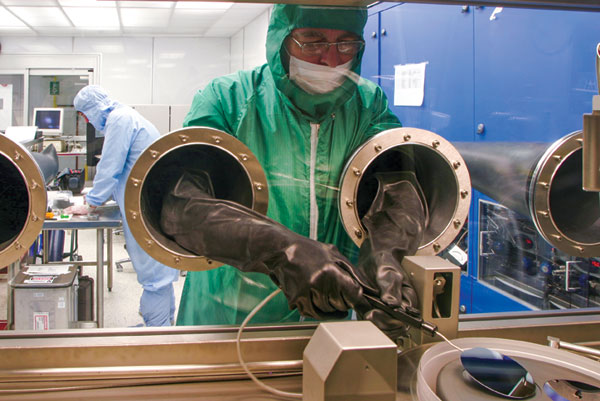 Tony SpringThorpe, a principal researcher with the Canadian Photonics Fabrication Centre in Ottawa, loading an MOCVD reactor with single crystal InP wafers on which will be deposited epitaxial layers of indium phosphide and gallium arsenide-based alloys to form laser structures.
