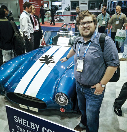 Andrew Finkle of Structure3D Printing in Ontario stands beside a fully functioning, electric 3D printed Shelby Cobra racing car. The body and chassis were printed with materials formulated by Techmer Engineered Solutions in the United States. The company created a unique carbon fibre-based formula for 3D printing that is 200 to 500 times faster than previous systems.