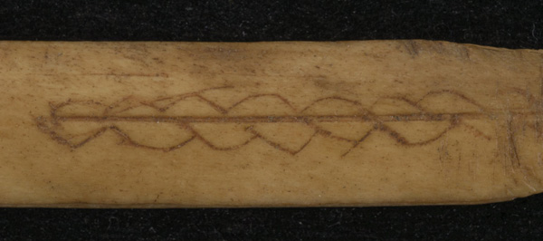 "A ""maker's mark"" left by the unknown person who crafted this Arctic hunting dart thousands of years ago, which was analyzed at the Canadian Conservation Institute in Ottawa."