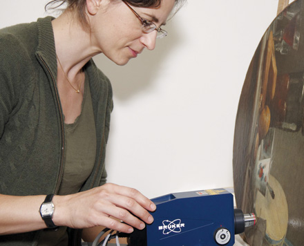 Senior conservation scientist Kate Helwig carries out non-invasive Raman spectroscopy of a painting at the Canadian Conservation Institute.