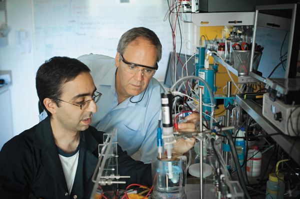 (L-R) University of British Columbia researchers Arman Bonakdarpour and David Wilkinson discuss ex-situ electrochemical measurements with a rotating disk electrode of one of the processes for the coupled water treatment/CO2 technology.