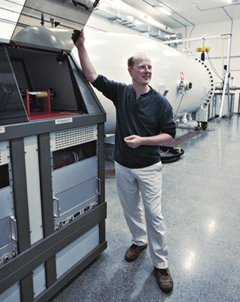 Mark Daymond, NSERC Industrial Research Chair in Nuclear Materials at Queen's University, beside the accelerator that is the centrepiece of a new materials testing laboratory.