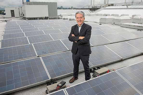 Hassan Farhangi, director of BCIT's Group for Advanced Information Technology, stands on the roof of the campus building that houses a microgrid to model the effects of cyber attacks.