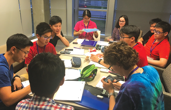 Students solve theoretical chemistry problems at the Canadian Chemistry Olympiad championship.