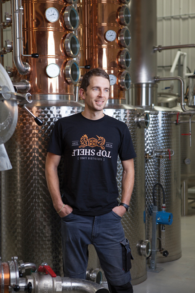 Top Shelf distiller Andy Hawkey brings a background in chemistry and an eagerness to explore the potential of spirit-based beverages. Photo Credit: Nick Lafontaine