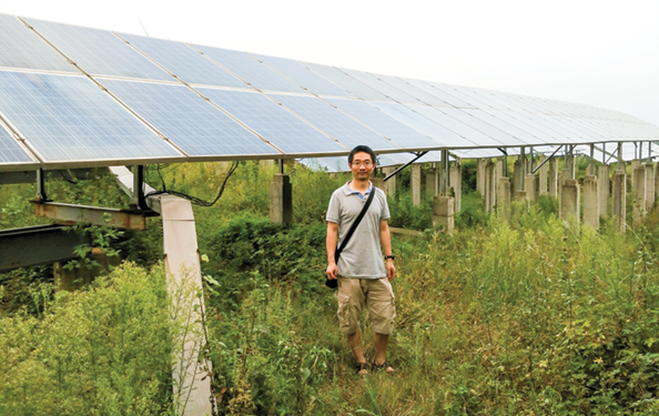Through his company Phantin, Cheng Lu, pictured here at a solar farm in Jiangsu province in China, has developed a nanomaterials-based,  self-cleaning, hydrophilic coating for solar panels. The coating prevents grime build up, which reduces solar panel efficiency by up to 50 percent.