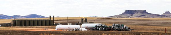 A mobile, skid-mounted Berg-GTUIT refrigeration unit operating in North Dakota's Bakken shale oilfield.