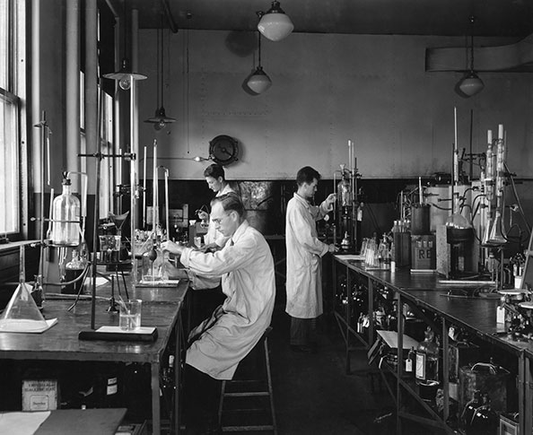 The general chemical laboratory at the Imperial Oil refinery at Sarnia, circa 1933-34. Researchers examine­ the oils for chemical defects and run special tests to determine lubrication properties.