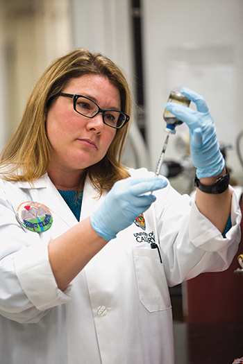 Microbiologist Lisa Gieg uses genomic­ tools to analyze  corrosion-inducing microbes in her University of Calgary laboratory.