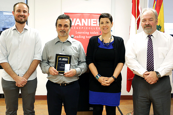 Fabien Hamerer, Montreal CIC Local Section Chair (left) presents Jailson Lima (second from left) with his Beaumier Award. Also in attendance are Vanier College's Annie-Claude Banville Academic Dean and John McMahon, Director General.